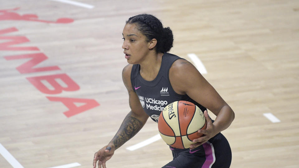 Chicago Sky forward Gabby Williams brings the ball up the court during the first half of a WNBA game against the New York Liberty on Aug. 25, 2020. (AP Photo/Phelan M. Ebenhack)