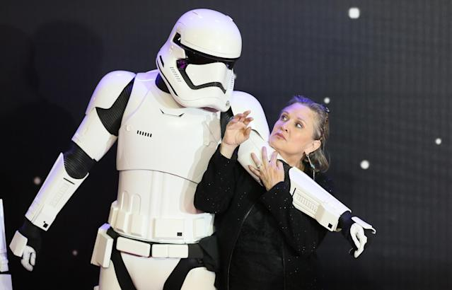 Carrie Fisher poses for cameras as she arrives at the European Premiere of Star Wars, The Force Awakens in Leicester Square, London, December 16, 2015. REUTERS/Paul Hackett