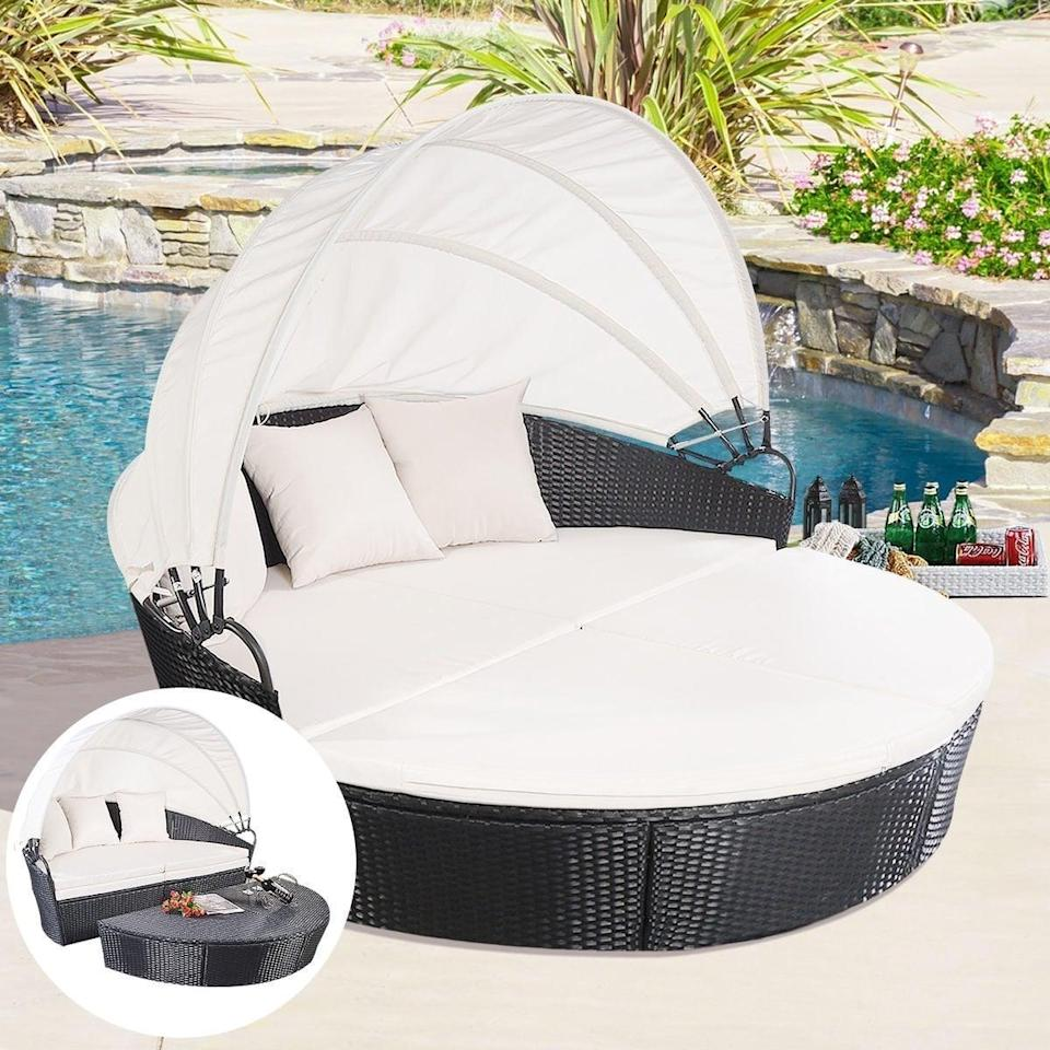 <p>Bring a tropical resort to your backyard by lounging in this <span>Homall Backyard Poolside Garden Round With Retractable Canopy Wicker Rattan</span> ($420, originally $460). </p>