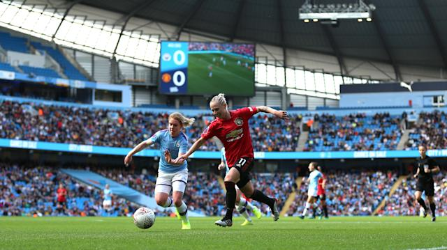 Manchester City Women's Aoife Mannion (L) and Manchester United's Leah Galton battle for the ball during the FA Women's Super League match at the Etihad Stadium, Manchester. (Getty Images)