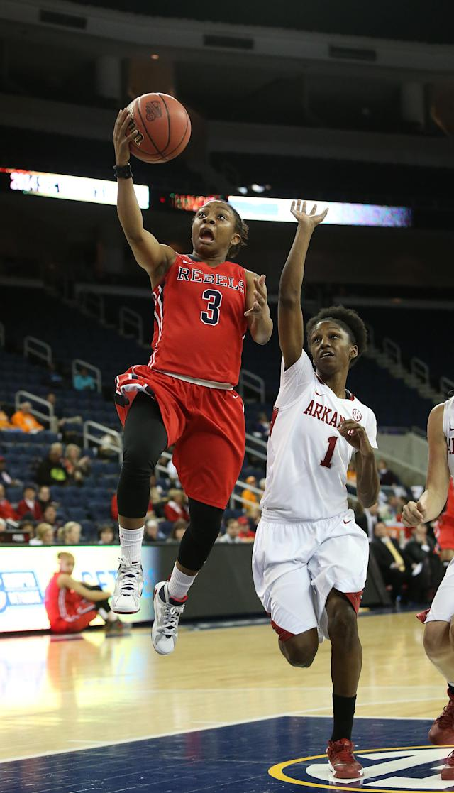 Mississippi guard Valencia McFarland (3) goes up for a basket as Arkansas forward Keira Peak (1) defends in the first half of a first-round women's Southeastern Conference tournament NCAA college basketball game Wednesday, March 5, 2014, in Duluth, Ga. (AP Photo/Jason Getz