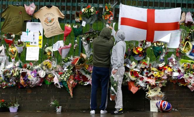 Well-wishers leave flowers where 25-year-old soldier Lee Rigby was killed in south London.
