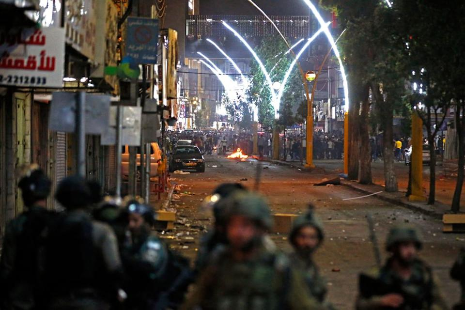 Israeli security forces deploy amid clashes with Palestinian demonstrators on May 12 as violence flared.