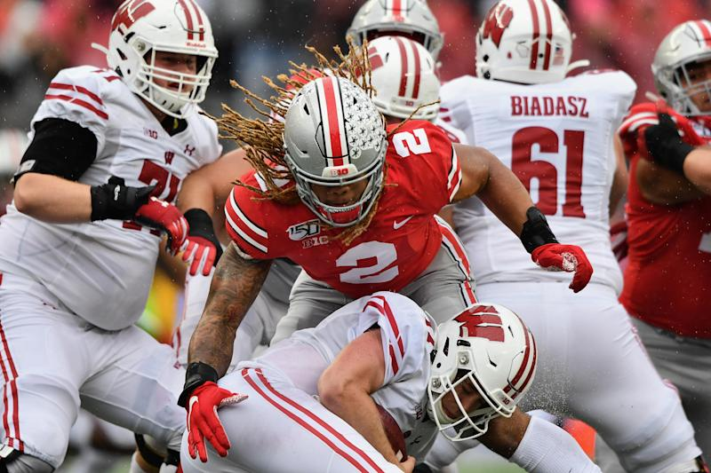 COLUMBUS, OH - OCTOBER 26: Quarterback Jack Coan #17 of the Wisconsin Badgers is sacked in the second quarter by Chase Young #2 of the Ohio State Buckeyes at Ohio Stadium on October 26, 2019 in Columbus, Ohio. (Photo by Jamie Sabau/Getty Images)