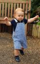 <p>Like these railroad stripe overalls with a navy polo. [Photo: Rex] </p>