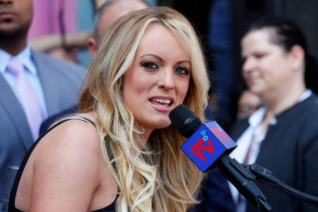 FILE PHOTO: Stormy Daniels, the porn star currently in legal battles with U.S. President Donald Trump, speaks during a ceremony in her honor in West Hollywood, California, U.S., May 23, 2018.  REUTERS/Mike Blake/File Photo