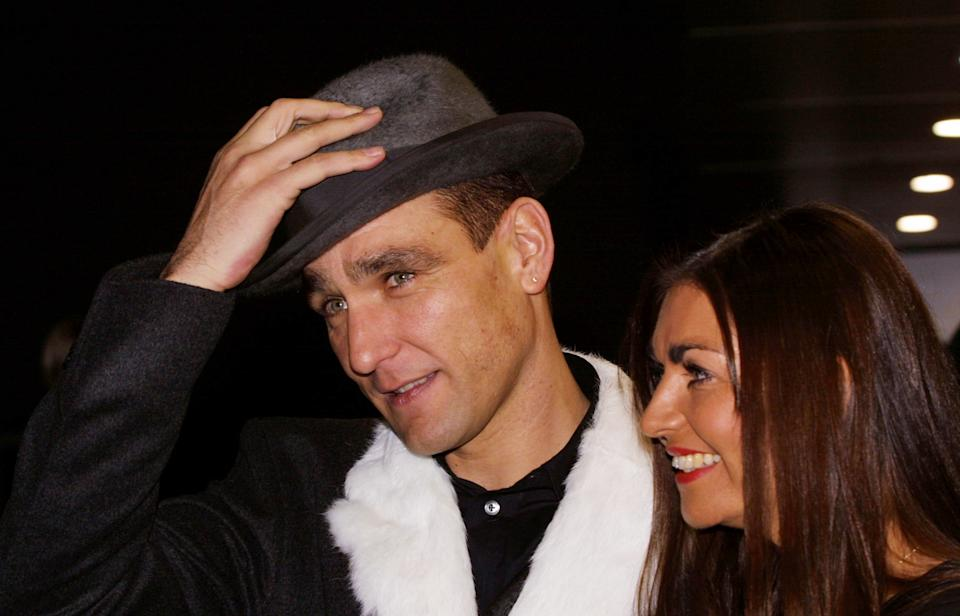 398820 04: Actor and former soccer player Vinnie Jones arrives with his wife Tanya for the World Premiere of the film ''Mean Machine'' December 18, 2001 at the Kensington Odeon cinema in London. The film stars Vinnie Jones and is executive produced by Guy Ritchie. (Photo by Sion Touhig/Getty Images)