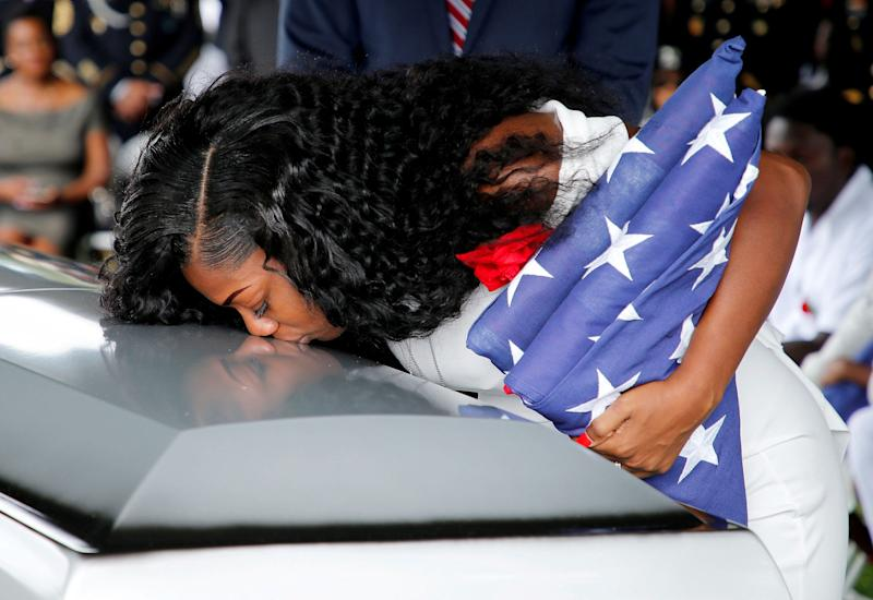 Johnson kisses her late husband's coffin at a graveside service in Hollywood, Florida, October 21, 2017.