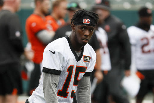 Cincinnati Bengals wide receiver John Ross prepares to run a play during practice at the NFL football team's training camp, Tuesday, June 12, 2018, in Cincinnati. (AP Photo/John Minchillo)