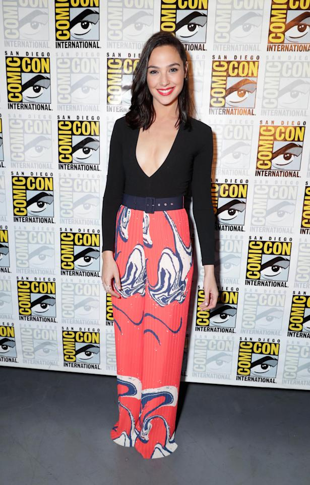 <p>Gal stood out in statement trousers as she attended a presentation. [<i>Photo: REX]</i></p>