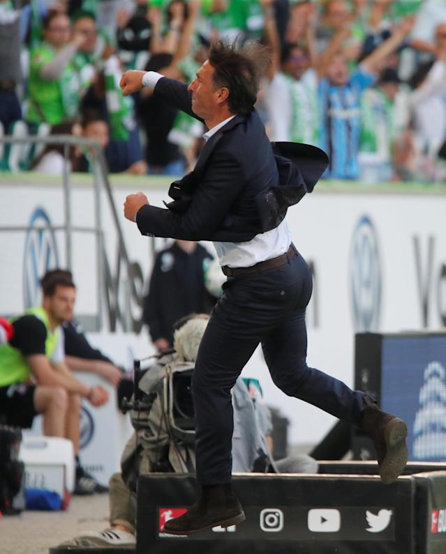 Soccer Football - Bundesliga - VfL Wolfsburg v FC Cologne - Volkswagen Arena, Wolfsburg, Germany - May 12, 2018 Wolfsburg coach Bruno Labbadia celebrates after Robin Knoche scores their third goal REUTERS/Wolfgang Rattay DFL RULES TO LIMIT THE ONLINE USAGE DURING MATCH TIME TO 15 PICTURES PER GAME. IMAGE SEQUENCES TO SIMULATE VIDEO IS NOT ALLOWED AT ANY TIME. FOR FURTHER QUERIES PLEASE CONTACT DFL DIRECTLY AT + 49 69 650050