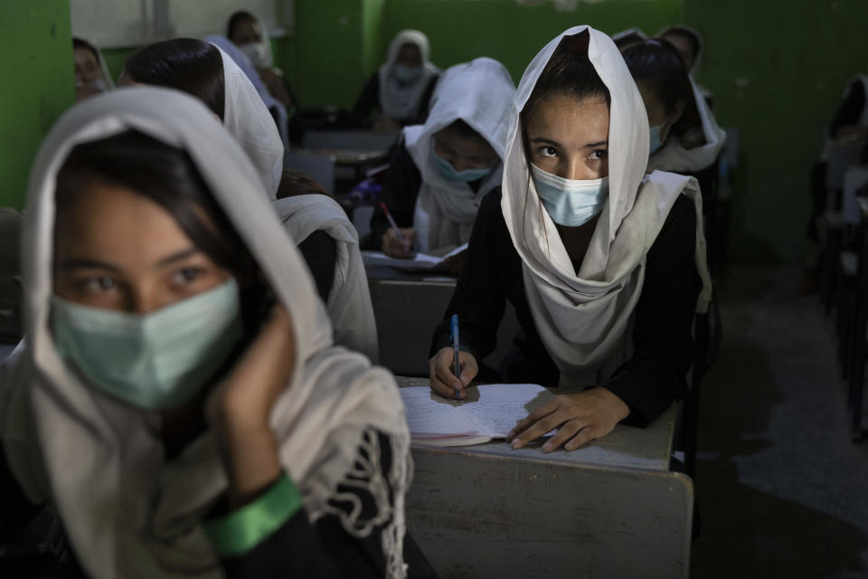 A female student listens during 10th grade class