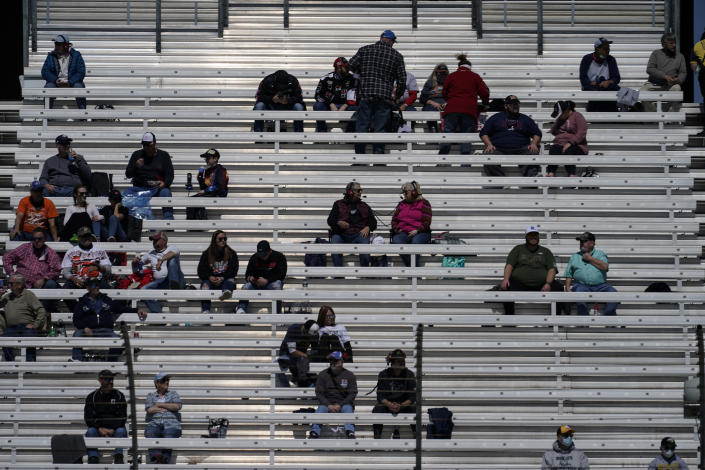 NASCAR fans are seen in the stands during a NASCAR Camping World Truck Series at Atlanta Motor Speedway on Saturday, March 20, 2021, in Hampton, Ga. (AP Photo/Brynn Anderson)