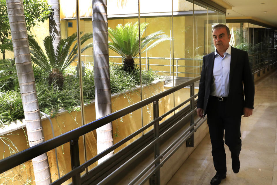 Fugitive ex-auto magnate Carlos Ghosn arrives for an interview with The Associated Press, in Dbayeh, north of Beirut, Lebanon, Tuesday, May 25, 2021. The embattled former chairman of the Renault-Nissan-Mitsubishi alliance dissected his legal troubles in Japan, France and the Netherlands, detailed how he plotted his brazen escape from Osaka, and reflected on his new reality in crisis-hit Lebanon, where he is stuck for the foreseeable future. (AP Photo/Hussein Malla)