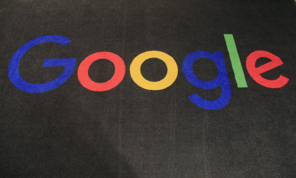 FILE - In this Monday, Nov. 18, 2019 file photo, the logo of Google is displayed on a carpet at the entrance hall of Google France in Paris. Google is heading to a top European Union court Monday Sept, 27, 2021, to appeal a record EU antitrust penalty for stifling competition by abusing the dominance of its Android operating system. (AP Photo/Michel Euler, File)