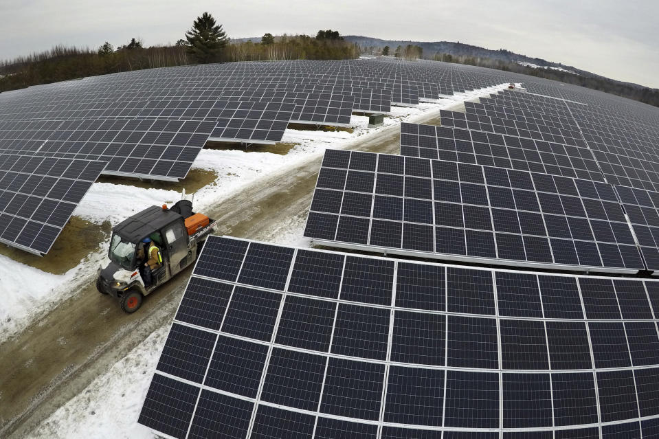 Solar panels stretch across 38 acres at the BNRG/Dirigo solar farm, Thursday, Jan. 14, 2021, in Oxford, Maine. President Joe Biden wants to change the way the U.S. uses energy by expanding renewables, but faces several challenges. (AP Photo/Robert F. Bukaty)