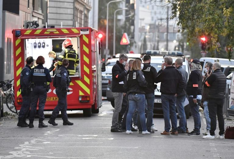 Security and emergency personnel at the scene of the attack in Lyon on Saturday