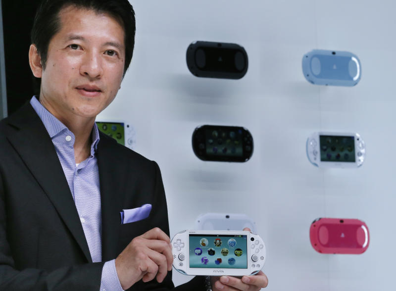Hiroshi Kawano, Sony Corp.'s chief of the game business in Japan and Asia, holds a new model of PSVita, a handheld game console, during an event in Tokyo, Monday, Sept. 9, 2013. (AP Photo/Koji Sasahara)
