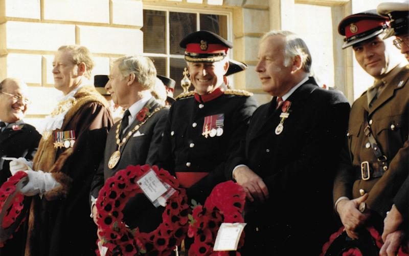 Hall, centre, on Remembrance Sunday, 1990