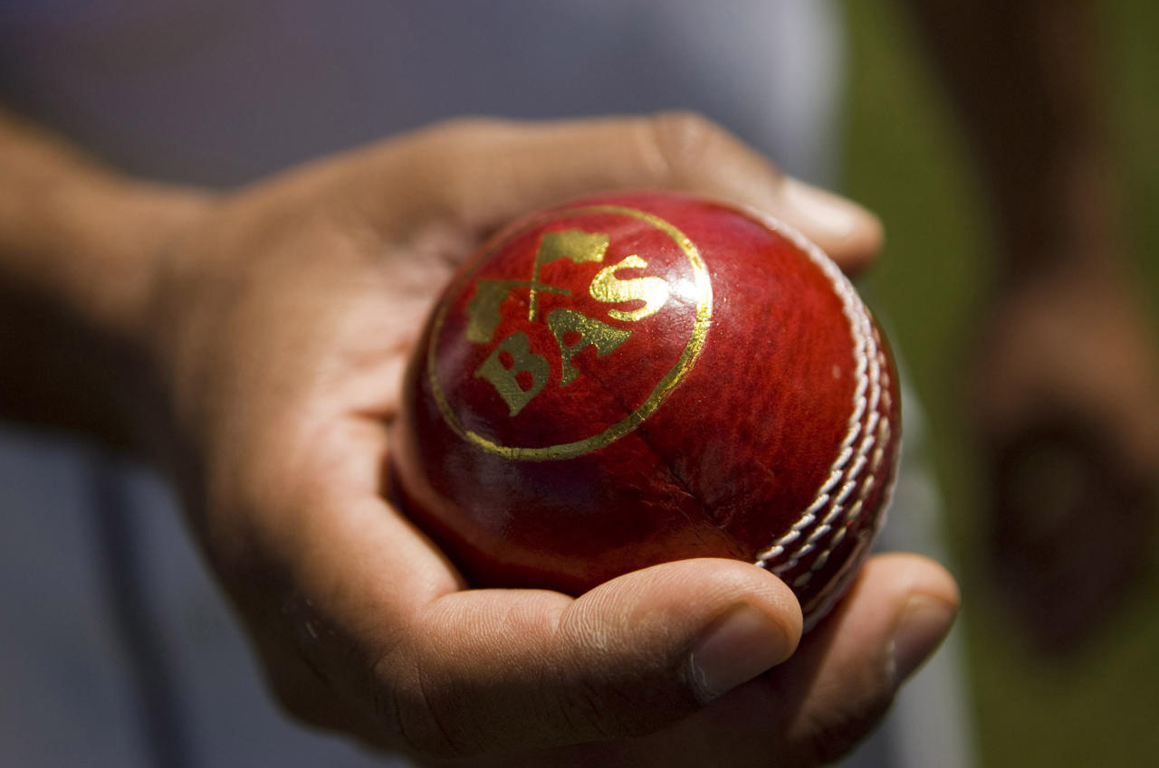 A cricket ball is made out of leather and the players do not wear gloves to catch the ball with.  (Photo by Autumn Cruz/Sacramento Bee/MCT via Getty Images)
