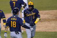 Milwaukee Brewers' Orlando Arcia (3) celebrates his two-run home run with Keston Hiura during the fourth inning in Game 1 of the team's National League wild-card baseball series against the Los Angeles Dodgers on Wednesday, Sept. 30, 2020, in Los Angeles. (AP Photo/Ashley Landis)
