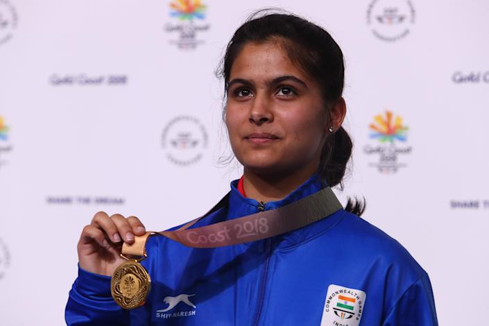 India's gold medallist Manu Bhaker poses with her medal after winning the women's 10m air pistol competition at the 2018 Gold Coast Commonwealth Games at the Belmont Shooting Complex in Brisbane on April 8, 2018. / AFP PHOTO / Patrick HAMILTON (Photo credit should read PATRICK HAMILTON/AFP via Getty Images)
