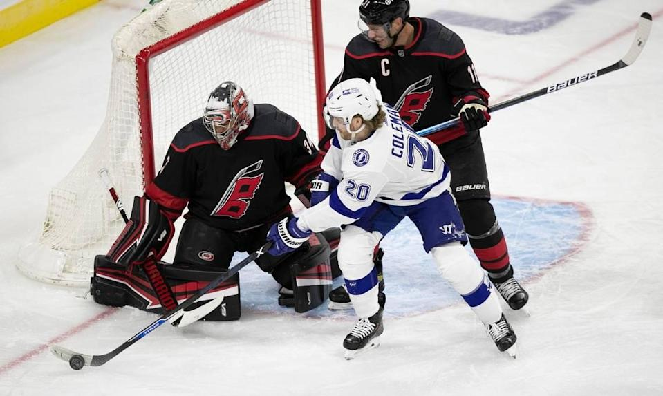 Tampa Bays Blake Coleman (21) tries to score on Carolina Hurricanes goalie Petr Mrazek (34) during the first period on Thursday, January 28, 2021 at PNC Arena in Raleigh, N.C.