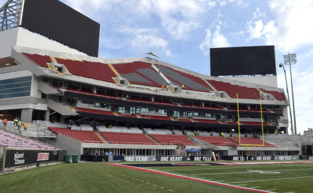 Work continues on the expansion of Cardinal Stadium, Wednesday, Sept. 5, 2018, in Louisville, Ky. The expansion adds about 6,000 seats to Cardinal Stadium, including expensive and exclusive field-level suites, premium boxes and club seats, among other amenities. Louisville plays Indiana State this week. (AP Photo/Timothy D. Easley)
