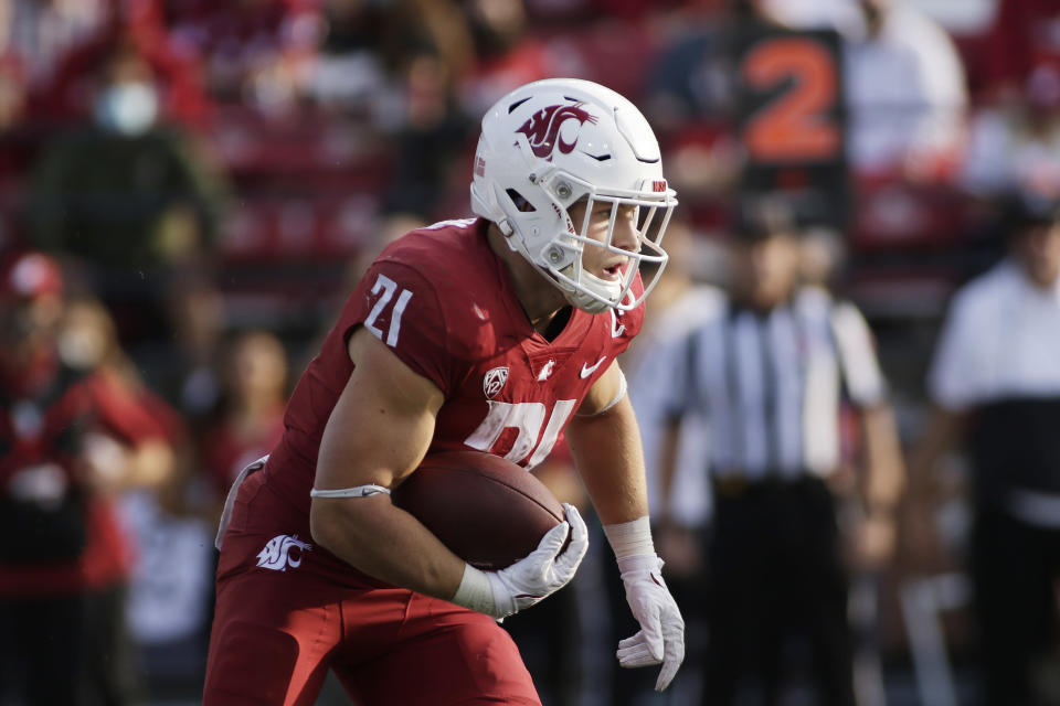 Washington State running back Max Borghi carries the ball during the second half of an NCAA college football game against Portland State, Saturday, Sept. 11, 2021, in Pullman, Wash. (AP Photo/Young Kwak)