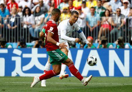 Soccer Football - World Cup - Group B - Portugal vs Morocco - Luzhniki Stadium, Moscow, Russia - June 20, 2018 Morocco's Medhi Benatia in action with Portugal's Cristiano Ronaldo REUTERS/Kai Pfaffenbach