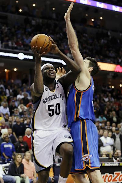 Memphis Grizzlies' Zach Randolph (50) shoots in front of Oklahoma City Thunder's Nick Collison in overtime of an NBA basketball game in Memphis, Tenn., Wednesday, March 20, 2013. The Grizzlies won 90-89. (AP Photo/Danny Johnston)