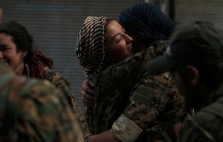 Syria Democratic Forces (SDF) female fighters embrace each other in the city of Manbij, in Aleppo Governorate, Syria, August 10, 2016. REUTERS/Rodi Said