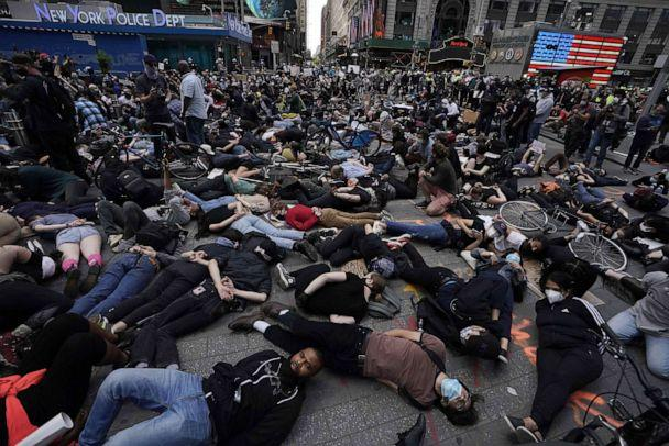 PHOTO: Protestors lay on the ground with their hands behind their back in a call for justice for George Floyd in Times Square on June 1, 2020, during a 'Black Lives Matter' protest in New York. (Timothy A. Clary/AFP via Getty Images)