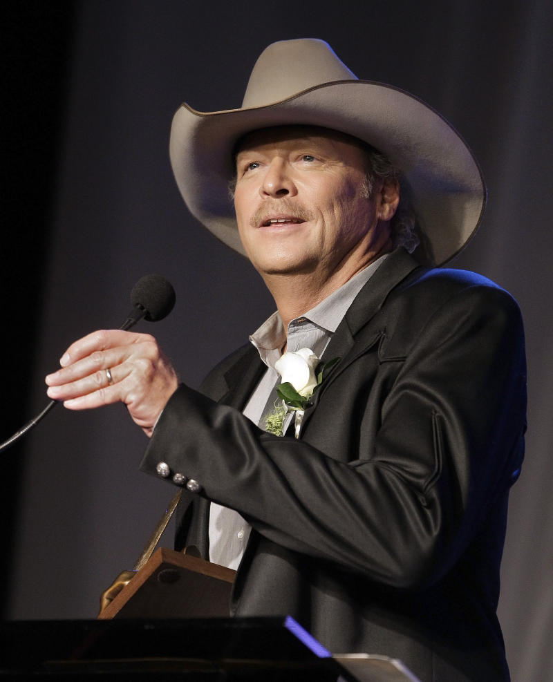 FILE -- In an Oct. 16, 2011 file photo Alan Jackson speaks as he is inducted into the Nashville Songwriters Hall of Fame on Sunday, Oct. 16, 2011, in Nashville, Tenn.   Country singer Alan Jackson has raised more than $150,000 to help a Virginia county rebuild schools damaged by last year's earthquake.   (AP Photo/Mark Humphrey/file)