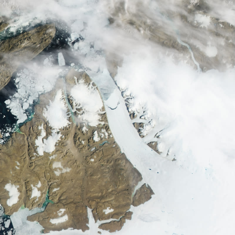 This Monday, July 16, 2012 satellite image provided by NASA shows calving, crescent-shaped crack at center, on the Petermann Glacier in northwestern Greenland. An iceberg twice the size of Manhattan tore off one of Greenland's largest glaciers. Scientists had been watching the 15-mile long crack in the floating ice shelf of the northerly Petermann Glacier for several years. On Monday NASA satellites showed it had broken completely, forming a 46 square mile iceberg. Petermann spawned an iceberg twice that size in 2010. (AP Photo/NASA)