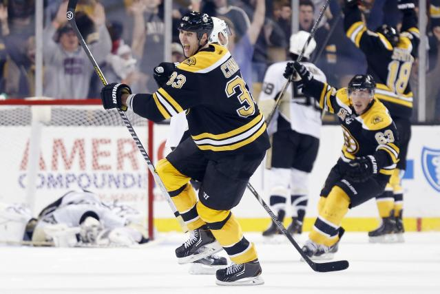Boston Bruins' Zdeno Chara (33) celebrates after scoring the go-ahead goal in the third period of an NHL hockey game against the Pittsburgh Penguins in Boston, Saturday, Dec. 7, 2013. The Bruins won 3-2. (AP Photo/Michael Dwyer)