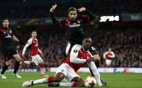 """Arsene Wenger has finally put an end to that unfortunate seven-year sequence of exiting Europe at the round of 16 stage, the only downside being that this time Arsenal are in the quarter-finals of the wrong competition. They live to fight another day in the Europa League despite falling behind to AC Milan on the night, and the Emirates Stadium will see European football beyond March for the first time since they last reached the quarter-finals of the Champions League in 2010. That year they lost to Barcelona, holding the mighty Catalan club to a 2-2 draw at home, and since then it has been a case of ever dwindling returns for both Arsenal and their beaten opponents AC Milan. The team managed by Gennaro Gattuso, an irrepressible figure of emotion and fury on the touchline, took the lead through a wonderful goal from Hakan Calhanoglu and were then dealt a most grievous injustice when Danny Welbeck executed a blatant dive to win a penalty. There was nothing cunning or subtle about it, just an act of deception compounded by the incompetency of the Swedish officials in falling for it, and from the penalty spot the Englishman dispatched the equaliser. Welbeck is back in the England squad and ended this game with two goals, but one wonders what he was thinking with that tumble in the first half given the """"masters of diving"""" accusation that Wenger has recently levelled against English players, including Dele Alli. Wenger was vague afterwards about whether he had seen the dive but even he had to concede that the Italians """"were not happy"""" and promised to be honest with Welbeck once he had reviewed the incident. Danny Welbeck wins a soft-looking penalty to cancel out Milan's opener Credit: PA Gattuso, a touchline figure who looks permanently like he is contemplating throwing the first punch of a bar-room brawl, was surprisingly circumspect about the whole episode. """"Even when I was a player I tried to take advantage of certain situations,"""" he said. """"I am not going to judge thes"""