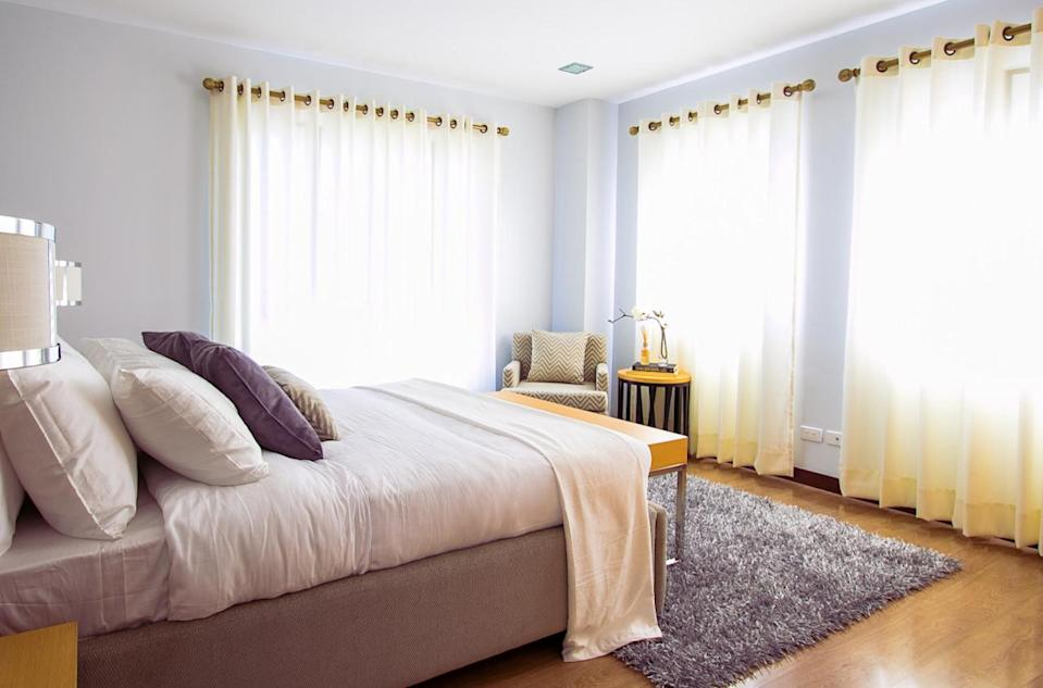 Avoid putting your bed right up against an exterior wall - it'll lose heat. [Photo: Pexels]