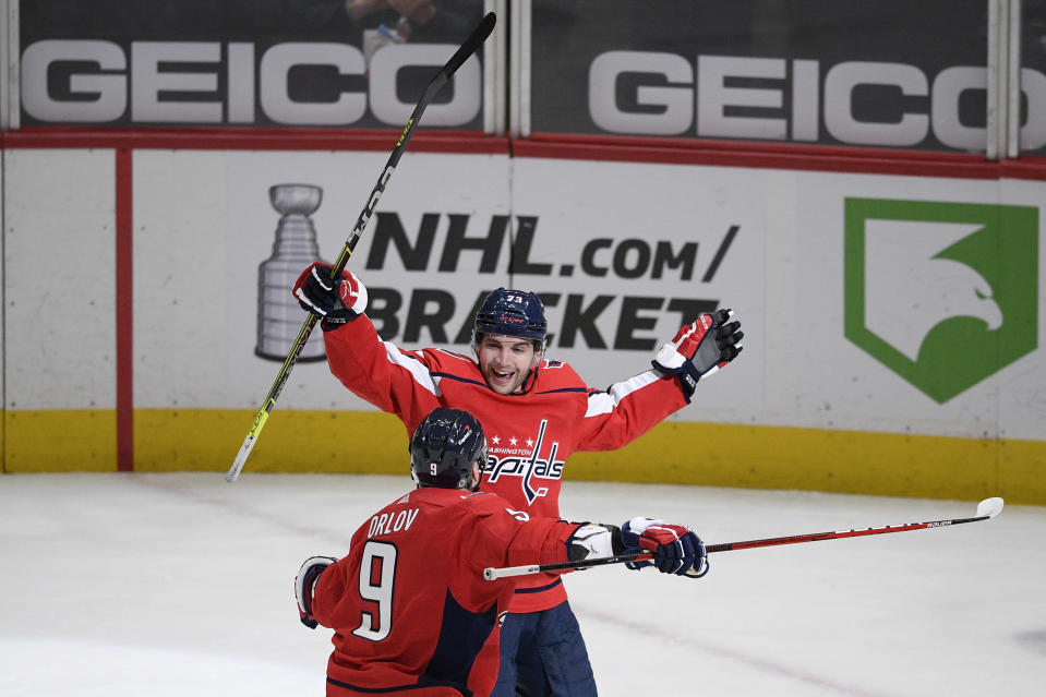 Washington Capitals left wing Conor Sheary celebrates his overtime goal against the Philadelphia Flyers with defenseman Dmitry Orlov (9) in an NHL hockey game Saturday, May 8, 2021, in Washington. The Capitals won 2-1. (AP Photo/Nick Wass)