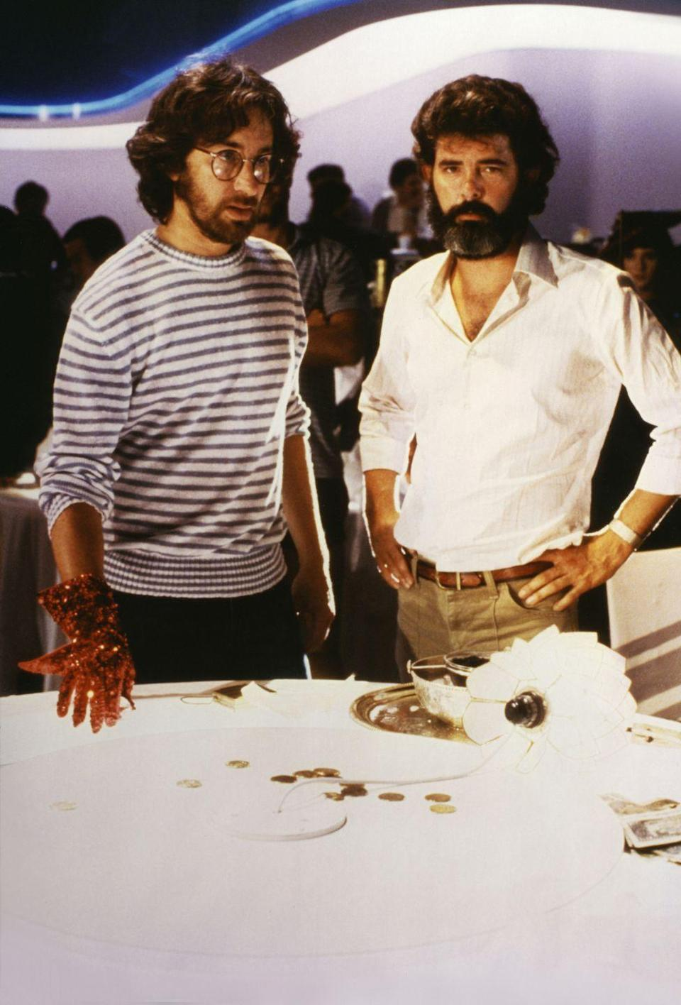 <p>Spielberg and producer George Lucas on the set of <em>Indiana Jones and the Temple of Doom</em>.</p>