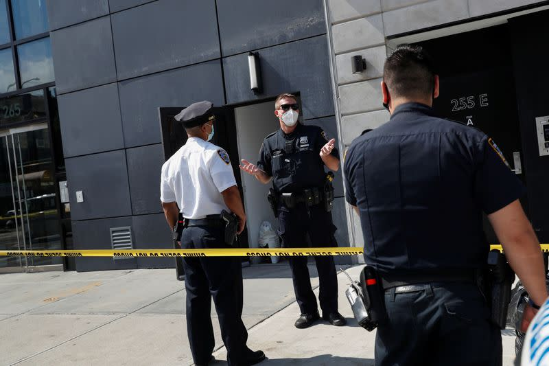 NYPD officers speak at crime scene at 265 Houston Street, where Fahim Saleh, Co-founder/CEO of Gokada, was found dead at the apartment building in New York City