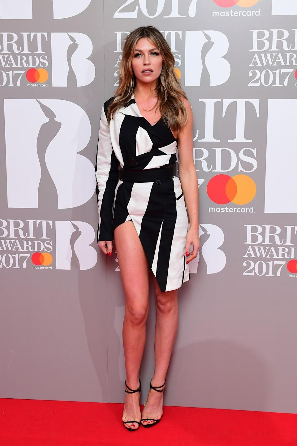<p>Abbey showed off her legs in a killer monochrome dress. <i>[Photo: PA]</i> </p>
