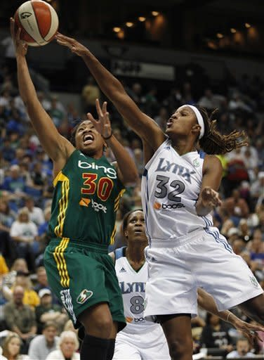 Seattle Storm guard Tanisha Wright (30) goes up to the basket against Minnesota Lynx forward Rebekkah Brunson (32) during the second half of Game 1 of the WNBA basketball first-round playoff series Friday, Sept. 28, 2012, in Minneapolis. The Lynx won 78-70. (AP Photo/Stacy Bengs)