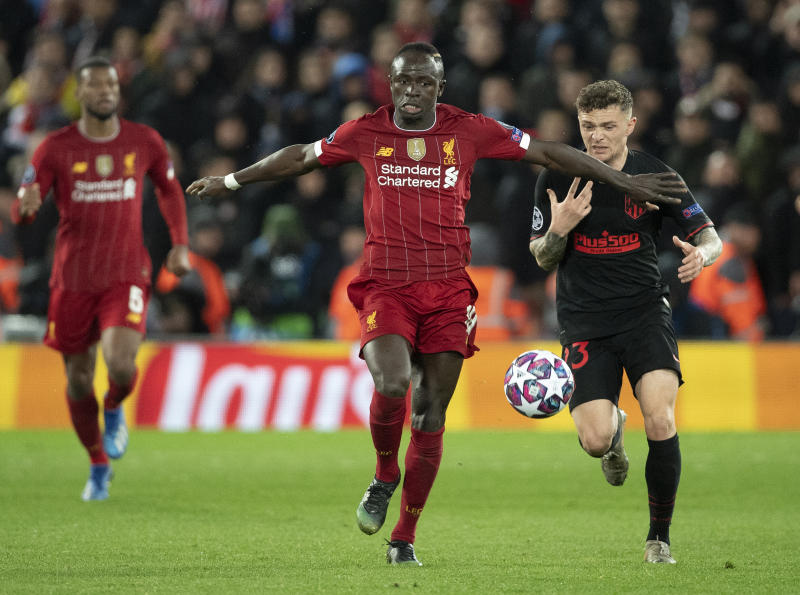 LIVERPOOL, ENGLAND - MARCH 11: Sadio Mane of Liverpool and Kieran Trippier of Atletico Madrid during the UEFA Champions League round of 16 second leg match between Liverpool FC and Atletico Madrid at Anfield on March 11, 2020 in Liverpool, United Kingdom. (Photo by Visionhaus)