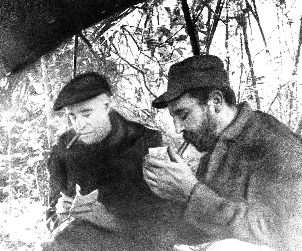 <p>Fidel Castro, right, Cuban rebel leader, is interviewed in his hideout in the Sierra Maestra by Herbert l. Matthews of the New York Times, Feb. 17, 1957. (AP Photo) </p>