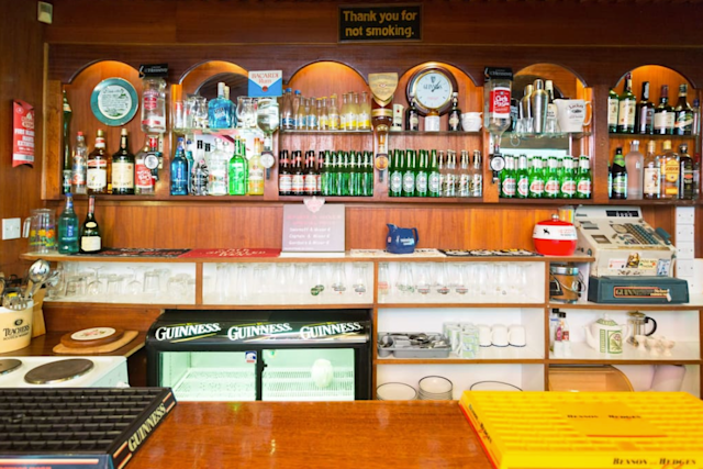 <p>The polished mahogany bar is equipped with pumps, optics and the original till. There's also a fully stocked kitchen. It wouldn't be a pub without games, and this bar has a darts board, a Skittles game (similar to bowling), as well as books, maps and other handy tourist information. (Airbnb) </p>