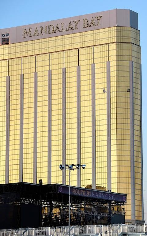 <span>The gunman shot at concert-goers from the 32nd floor of the Mandalay Bay hotel</span> <span>Credit: David Becker/Getty </span>