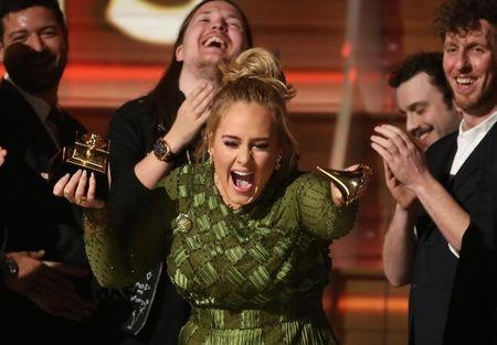 """Adele breaks the Grammy for Record of the Year for """"Hello"""" after having it presented to her at the 59th Annual Grammy Awards in Los Angeles, California, U.S., February 12, 2017. REUTERS/Lucy Nicholson"""