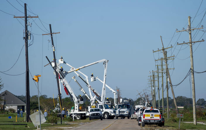 Work crews repair power lines south of Houma, La., following Hurricane Zeta on Thursday, Oct. 29, 2020. Gov. John Bel Edwards says officials are still assessing the extent of Zeta's damage across the southeastern parishes. (Chris Granger/The Advocate via AP)