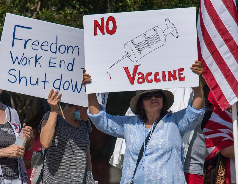Supporters of the US president hold a rally to call for the reopening of the California economy after the lockdown closure, implemented to stop the spread of the novel coronavirus (which causes Covid-19), in Woodland Hills, California, on May 16, 2020. (Mark Ralston/AFP via Getty Images)